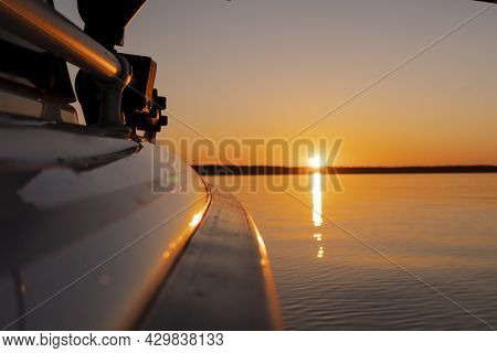 Side View Speeding Fishing Motor Boat With Drops Of Water. Blue Ocean Sea Water Wave Reflections At