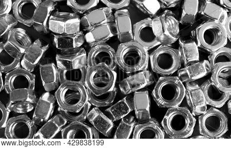 Metal Nuts In A Row Background. Chromed Screw Nut  Texture. Steel Nuts Pattern. Set Of Nuts. Tools F