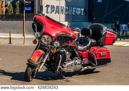 Motorcycle Harley-davidson Flhtk Electra Glide Ultra In Red Color. Touring Motorbike Parked On The S