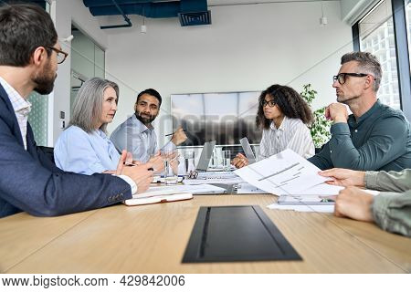 Diverse Professional Executive Business Team People Discuss Project Sitting At Meeting Table In Boar