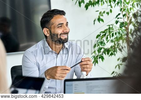 Friendly Happy Smiling Ceo Indian Businessman Holding Pen In Hand Looking Listening To Colleague Dis