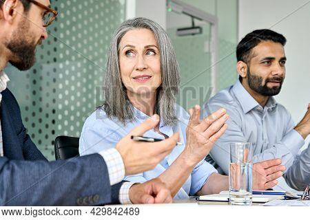 Smiling Senior Caucasian Female Ceo Executive Manager Looking At Male Manager Discussing Corporation