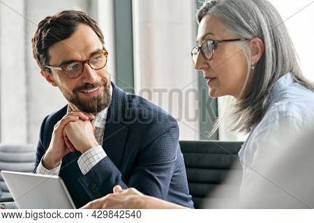 Happy Smiling Bearded Businessman In Eyewear With Clasped Hands Listening To Female Executive Manage