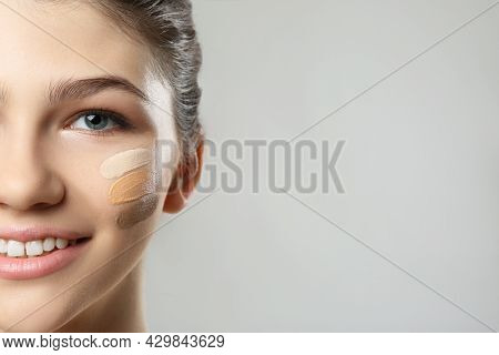 Beautiful Girl On Light Grey Background, Closeup. Using Concealers And Foundation For Face Contourin