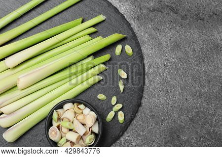 Fresh Lemongrass Stalks On Grey Table, Top View. Space For Text