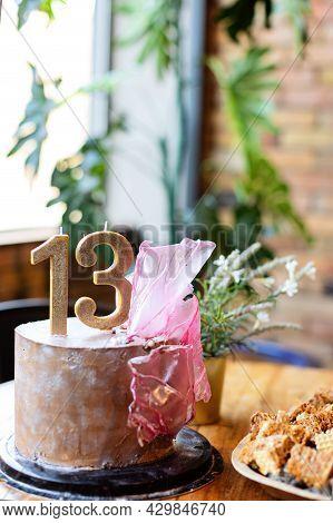 Birthday Celebration At Thirteen Years. Number 13 Celebration Birthday Cupcake