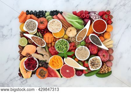 Healthy clean eating vegan food high in antioxidants that neutralise free radicals, high in fibre, anthocaynins, smart carbs, minerals, vitamins,  protein and omega 3. Natural health food concept.