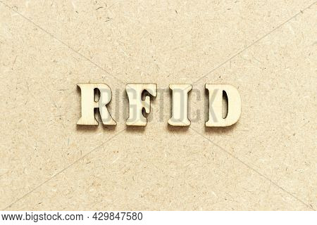 Alphabet Letter In Word Rfid (abbreviation Of Radio-frequency Identification) On Wood Background