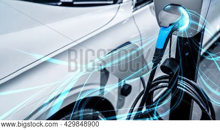 Ev Charging Station For Electric Car In Concept Of Green Energy And Eco Power Produced From Sustaina