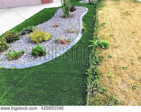 A Comparison Photo Of A  Artificial Synthetic Lawn Beside A Real Natural Grass In The Summer.  The A