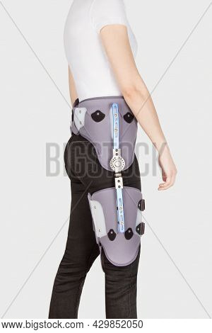 Hip Abduction Orthosis. Orthopedic Adjustable Support Brace For Knee And Hip Fixation. A Knee Brace