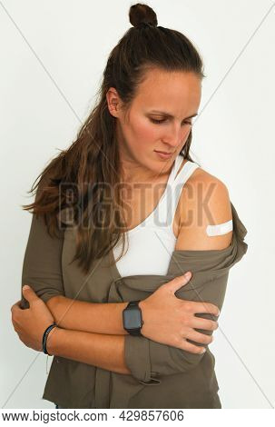 Coronavirus Vaccination Advertisement. Vaccinated Woman Showing Arm With Plaster Bandage After Covid