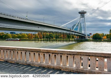 Bratislava, Slovakia - Oct 16, 2019: Bridge Through Danube. Sunny Weather With Clouds On The Sky. Ci