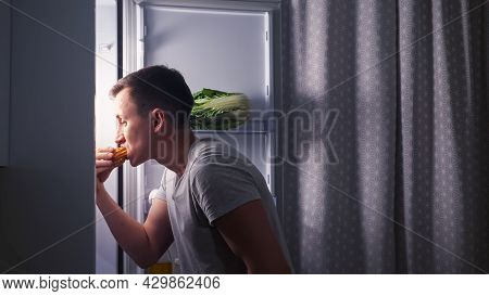 Careful Young Man Opens Door Of Modern Fridge And Eats Delicious Creamy Eclair In Secret Turning Bac
