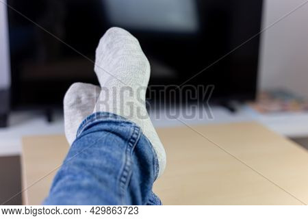 Lazy Holidays At Home, Relaxing Woman Laying In Sofa Front Of Tv, Holding Her Legs On A Table, Horiz
