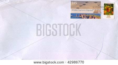 GERMANY - CIRCA 2010: A stamp printed in Germany shows image of the Vogelwarte Helgoland and Flower Golmohn , circa 2010.