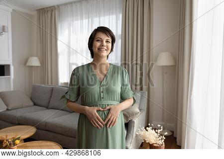 Happy Expectant Mom Holding Baby Bump With Love