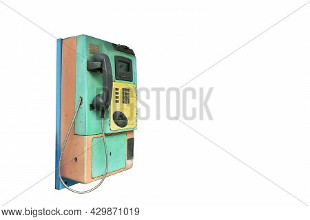 Old And Obsolete Public Telephone Booth Used By Insert Boin Or Card On White Background