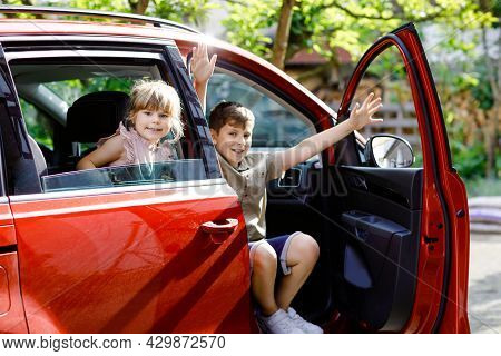 Two Children, School Boys Sitting In Car Before Leaving For Summer Vacation With Parents. Happy Kids