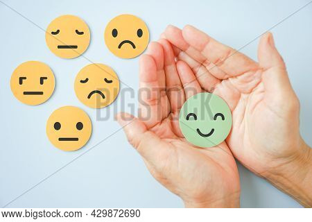 Hand Holding Happy Smile Face Paper Cut With Other On Background, Good Positive ,customer Review Fee