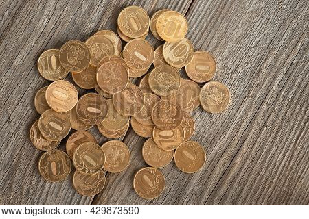 Coins With A Face Value Of 10 Rubles On A Wooden Table, Russian Rubles Background