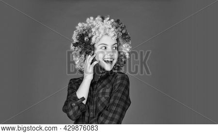 Positive And Cheerful. Childhood Happiness. Kid Looking Funny In Rainbow Wig Hair. Hair Dyeing At Ha