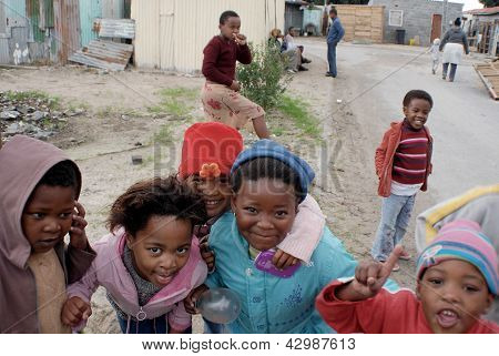 young children play on a street of Khayelitsha township