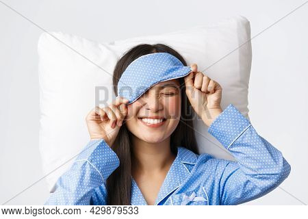 Pleased Happy Smiling Korean Girl In Blue Pajamas And Sleeping Mask, Had Great Day Going Bed In Perf