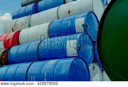 Old Chemical Barrels Stack. Red, Green, And Blue Chemical Drum. Steel Tank Of Flammable Liquid. Haza
