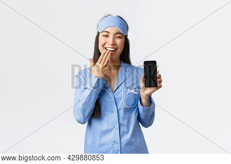 Technology, People And Home Leisure Concept. Happy Feminine Asian Girl In Pyjamas And Sleeping Mask,