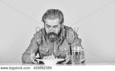 Man With Fast Food. Beer And French Fries In Restaurant. Eating And Drinking At Bar. Hipster Relax I