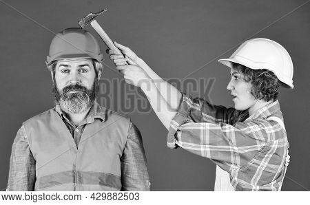 Couple Doing Apartment Repair Together Themselves. Man And Woman Wear Safety Helmet. Couple At The C