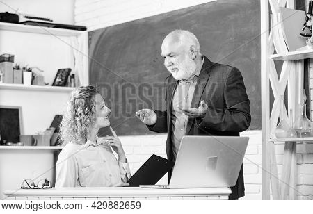 Work In Education. Man Mature School Teacher And Girl Student With Laptop. High School College Unive