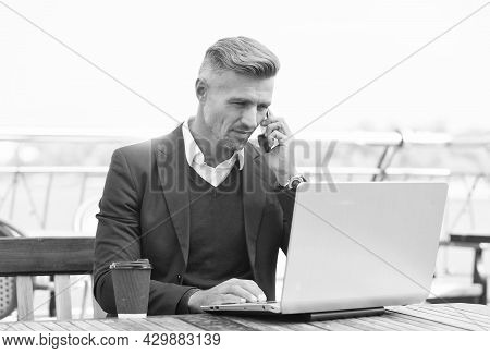 Freelancer Work Laptop Talking On Mobile Phone In Cyber Cafe Outdoors, Freelance