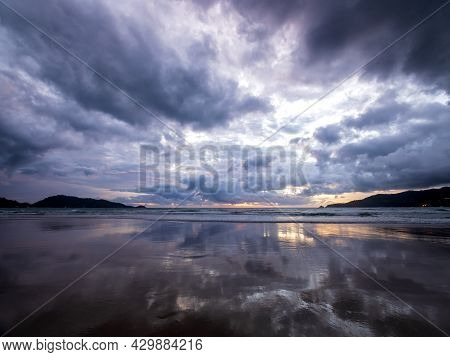 Beautiful Sunset Over The Calm Sea With Cloud And Sky Background. Sunset Over Tropical Beach. Nature