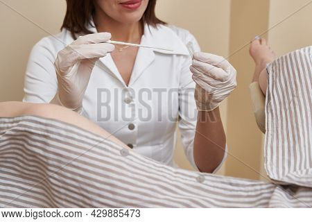 Gynecologist Doing Some Vaginal Examination And Tests Of The Patient Lying In Chair