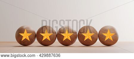 Golden Five Stars Print Screen On Wooden Balls On Table For  Excellent Rating Of Customer Evaluation