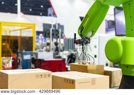 Close Up Precision Robot Arm And Automatic Vacuum Or Suction Cup For Pick - Place Transport Paper Bo