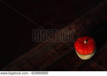 Flat Lay Top View Turban Squash, Cucurbit On Dark Wooden Background. Turkish Pumpkin With A Turban.