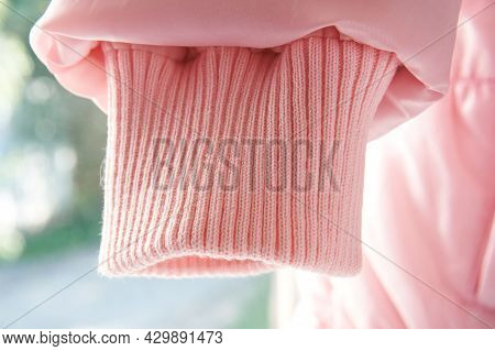Pink Sleeve Of Jacket Or Sweater, Cuff For Sealing. Narrowing Sleeves On A Light Background, Magky S