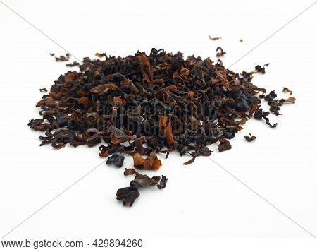 Dried Wakame Seaweed Isolated On White Background. Perspective View Of Handful Of Edible Seaweed. Fo