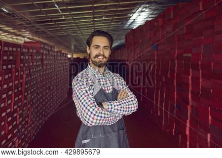 Footwear Factory Warehouse Worker Smiling At Camera Standing Among Shoe Box