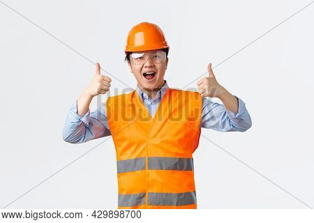 Building Sector And Industrial Workers Concept. Smiling Asian Male Engineer, Architect Or Builder In