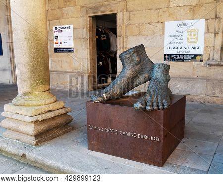 Santiago De Compostela, Spain - September 13, 2020: Feet Sculpture With Medical Plaster Near The Cat