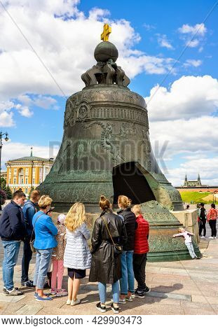 Moscow - June 2, 2021: Tourists Look At Tsar Bell In Moscow Kremlin, Russia. Huge Tsar Bell Is Large