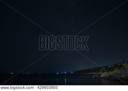 Coastline Of Mediterranean Sea In The Night Time. Milky Way Galaxy And Shooting Star. Starry Summer