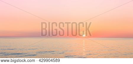 Sun Is Rising On Horizon At Sunset Or Sunrise Over Sea Or Ocean. Tranquil Sea Ocean Waves. Natural S