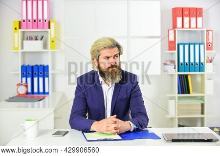 Concentrated On Work. Erp Consultant Making Notes. Company Executive Working With Documents. Mature