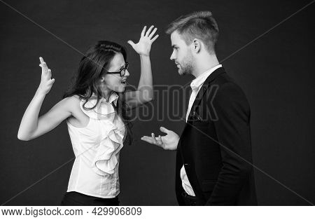 Disagreement Among Colleagues. Emotional Woman And Man Fight Dark Background. Professional Or Person