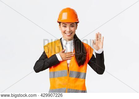 Sincere, Honest And Confident Asian Female Engineer At Building Area, Making Promise, Give Oath To C